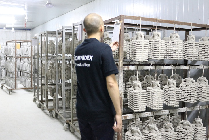 Experienced casting specialist checking the shell drying process